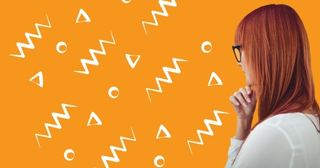 Digital composite of Woman in glasses profile against orange background with white patterns Stock Photo