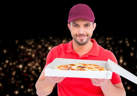 Digital composite of Deliveryman with the pizza in front of the city at night. Little lights