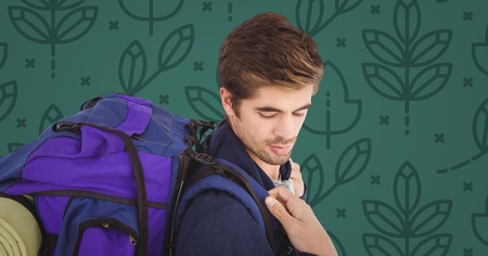 spare: Digital composite of Man with backpack against green nature pattern Stock Photo