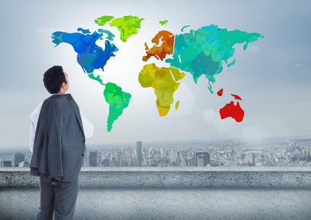 Digital composite of Businessman looking at Colorful Map with city background