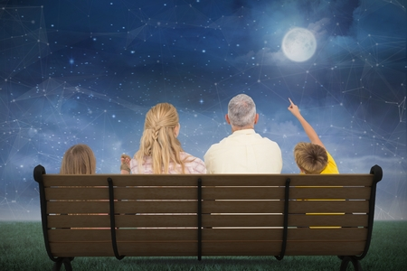 family constellation: Digital composite of Composite image of family watching the moon