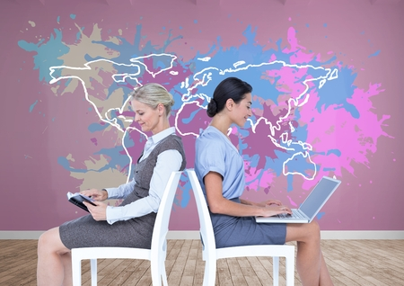 Digital composite of Businesswomen collaborating working in front of Colorful Map with paint splattered wall background