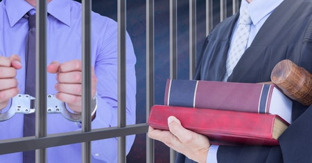 interned: Digital composite of Judge and criminal in front of prison cell bars Stock Photo