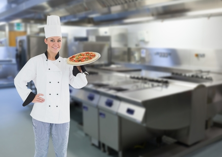 unhealthful: Digital composite of Chef with pizza in the restaurants kitchen