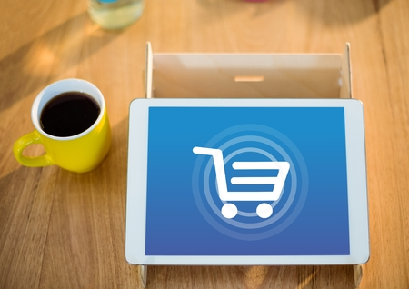 dull: Digital composite of Tablet with Shopping trolley icon and coffee
