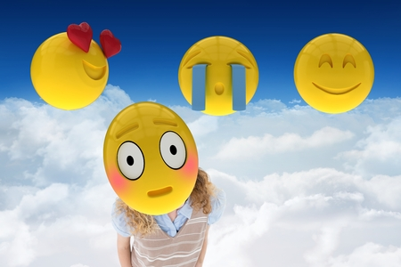 Digital composite of Composite image on smileys in 3d against a sky background Stock Photo
