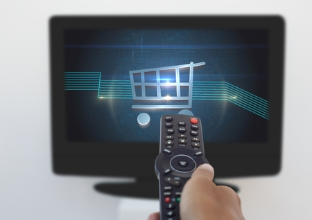 Digital composite of Person using Tv Remote with Shopping trolley icon