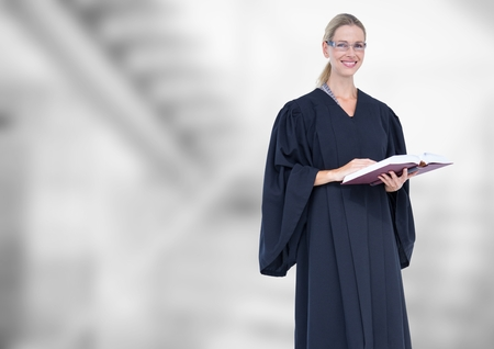 staircases: Digital composite of Judge holding book in front of bright staircase Stock Photo