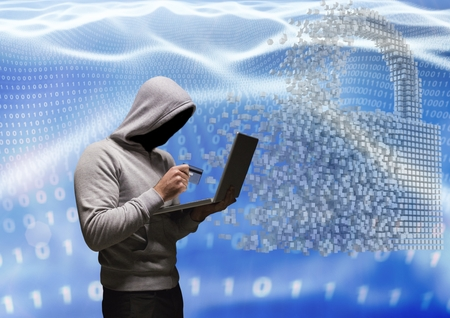 Digital composite of Grey jumper hacker with out face with the credit card and computer in code sea with lock
