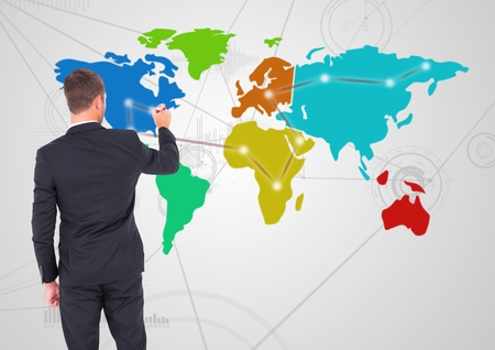 interned: Digital composite of Businessman drawing on Colorful Map with Connector background