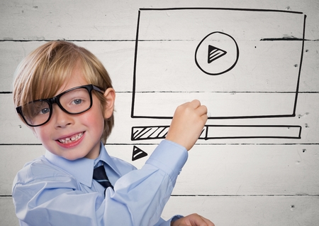 Digital composite of Kid with chalk and website mock up against white wood panel