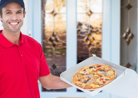 Digital composite of Happy deliveryman in the door of the house showing the pizza