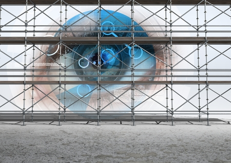 western script: Digital composite of Eye technology interface with 3D Scaffolding