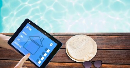 personal perspective: Digital composite of Hands using smart home application on tablet PC at poolside