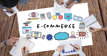 Digital composite of E-commerce text surrounded by graphics and business peoples hands Stock Photo