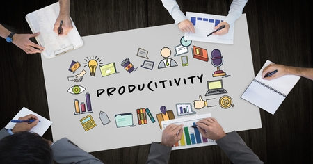 western script: Digital composite of Productivity text surrounded by graphics and business peoples hands Stock Photo