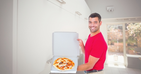 Digital composite of Happy man showing pizza in box