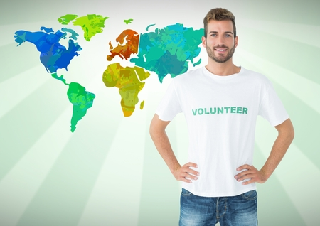Digital composite of Volunteer in front of Colorful Map Stock Photo
