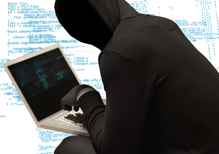 Digital composite of Black jumper hacker with out face with computer, white and blue code background