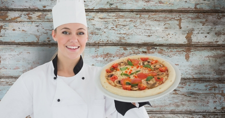 3d pizza: Digital composite of Composite image of smiling female chef with pizza