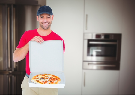 Digital composite of Happy deliveryman showing the pizza in the kitchen