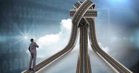 Digital composite of Digital composite image of businessman standing on jumbled highway