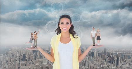 Digital composite of Digitally generated image of people standing on standing on woman palm against city