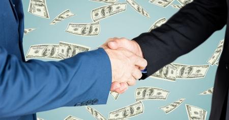 introducing: Digital composite of Business people doing handshake money in background