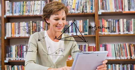 Digital composite of Digitally generated image of geometric structure with woman using digital tablet in library Stock Photo