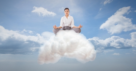 Digital composite of Digitally generated image of businesswoman meditating on cloud in sky
