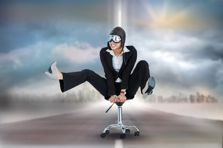 pilot light: Digital composite of Digitally generated image of businesswoman with goggles on office chair at road against sky Stock Photo