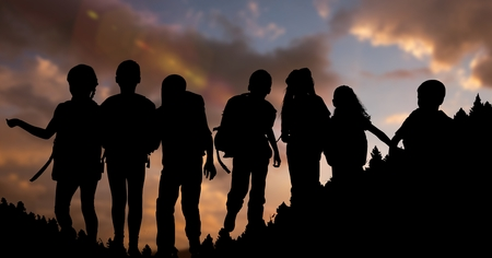 horizon over land: Digital composite of Silhouette children with backpacks during sunset