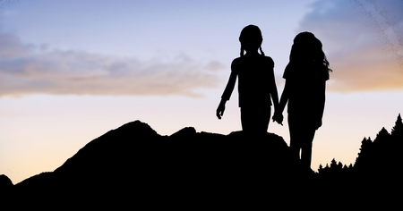 horizon over land: Digital composite of Silhouette girls holding hands on mountain against sky