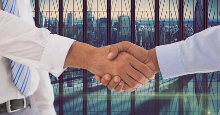 western script: Digital composite of Cropped image of businessmen shaking hands Stock Photo