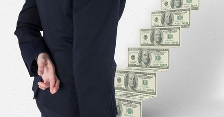 midsection: Digital composite of Midsection of business person crossing fingers with money in background Stock Photo