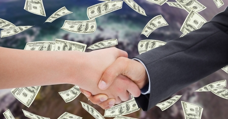 non urban scene: Digital composite of Close-up of business people shaking hands with money in background Stock Photo