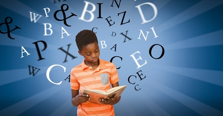 Digital composite of Male student studying while alphabets flying in background
