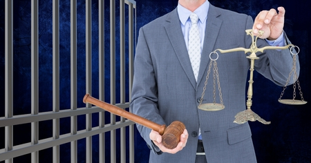 interned: Digital composite of Businessman holding judge gavel and scales by prison cell