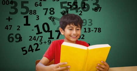 literature: Digital composite of Boy studying while numbers flying in background Stock Photo