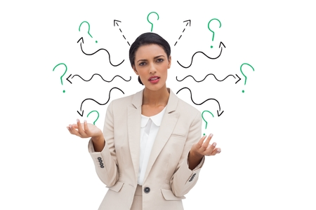 Digital composite of Confused businesswoman with arrows and question marks