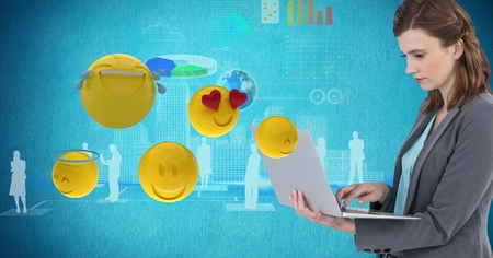 Digital composite of Digital composite image of businesswoman using laptop by various emojis Stock Photo