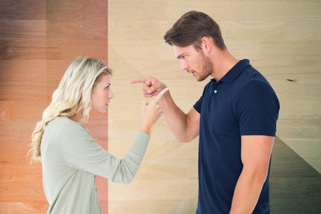 wrath: Digital composite of Side view of man and woman pointing while arguing