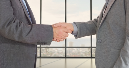 midsection: Digital composite of Midsection of business professionals shaking hands