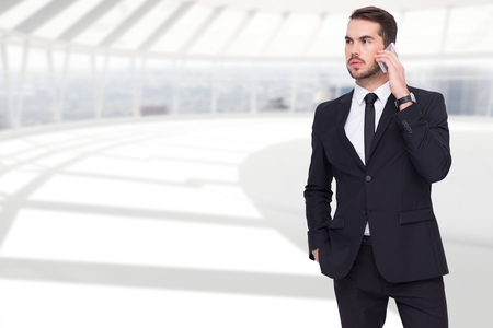 Digital composite of Businessman using mobile phone in office
