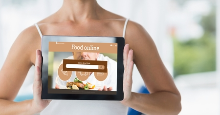 midsection: Digital composite of Midsection of woman holding digital tablet with food online page