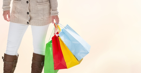midsection: Digital composite of Midsection of woman with colorful shopping bags Stock Photo