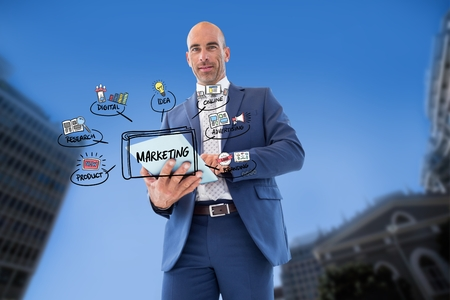 cowering: Digital composite of Businessman using tablet PC with marketing icons in city