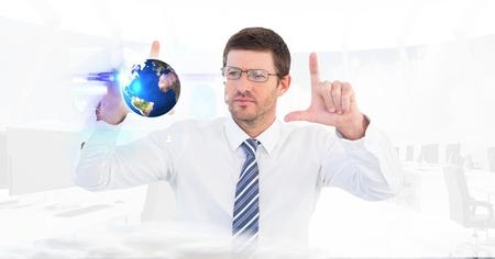 smolder: Digital composite of Digital composite image of businessman making hand frame while looking at globe