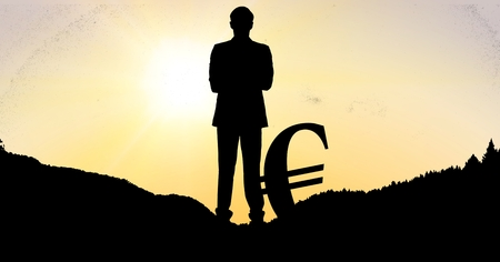 illuminated: Digital composite of Silhouette businessman with euro sign on field during sunset