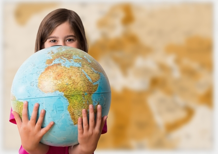 Digital composite of Girl with globe against blurry brown map